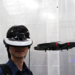 Flying Head: A Head Motion Synchronization Mechanism for Unmanned Aerial Vehicle Control